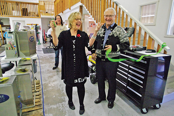 MP Elizabeth May cuts the ribbon as Sidney company Empire Hydrogen Energy Systems and owner Sven Tjelta announced the expansion of a second production line for their innovative fuel enhancement system.